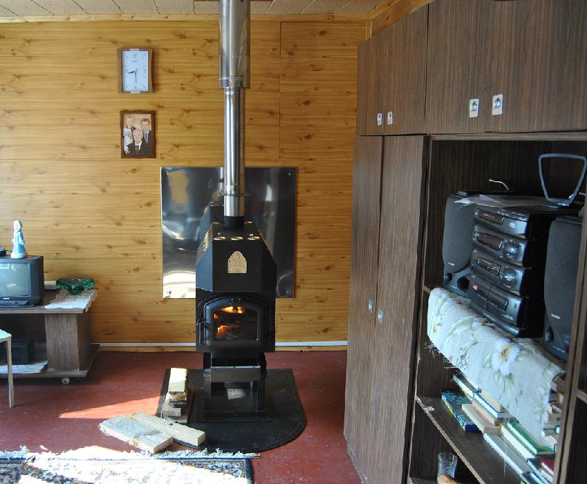 Установка отопительной печи в деревянном доме 155